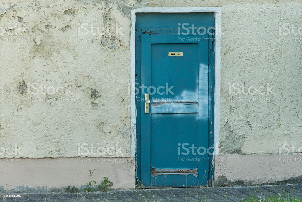 Old house with an door with german word for kitchen stock photo