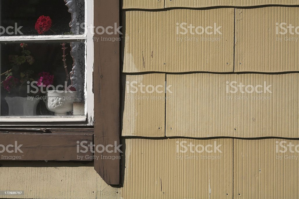 Old house with facade of asbestos mats. royalty-free stock photo