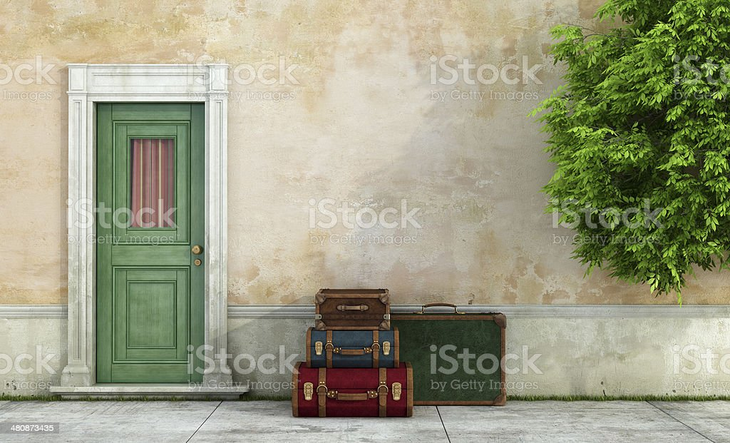 Old house with vintage suitcases stock photo