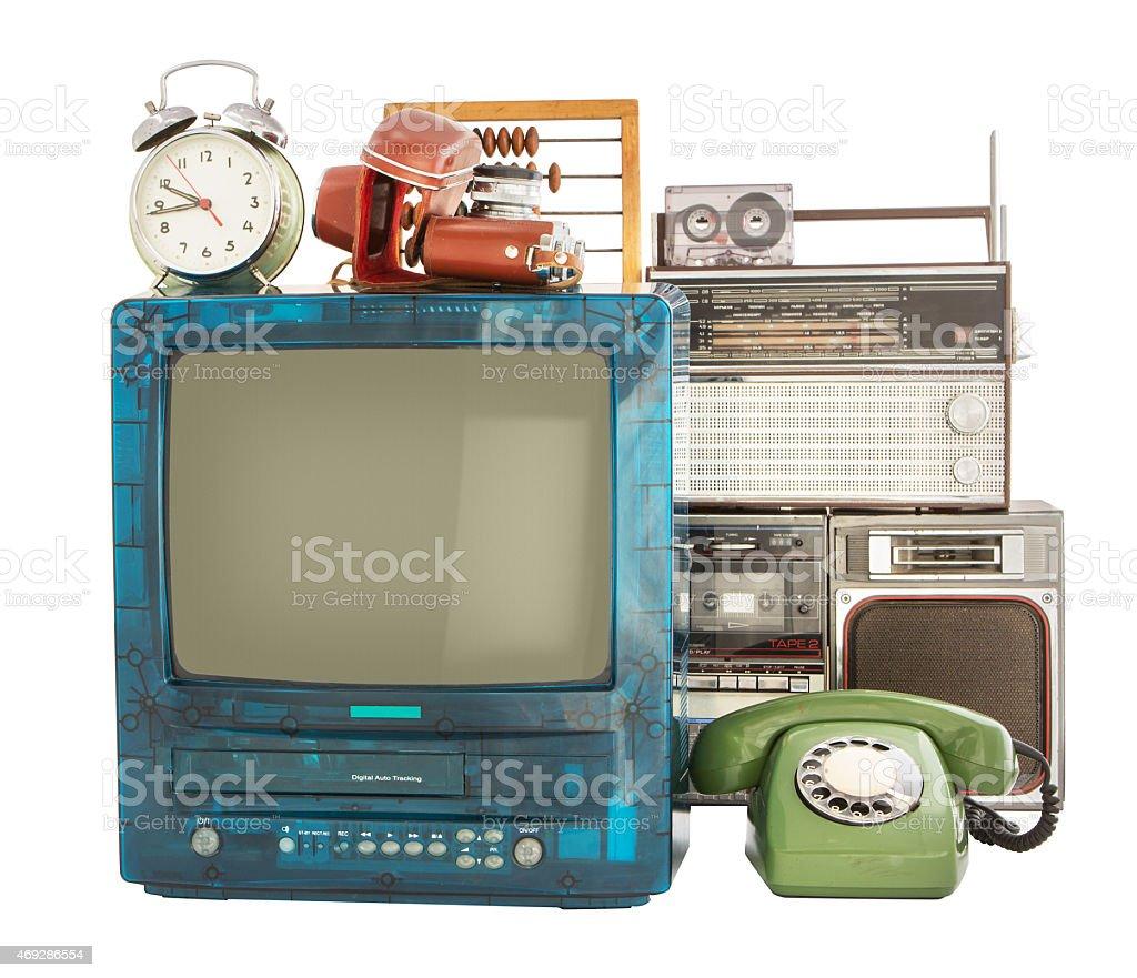 Old household items like clock radio rotary phone TV stock photo