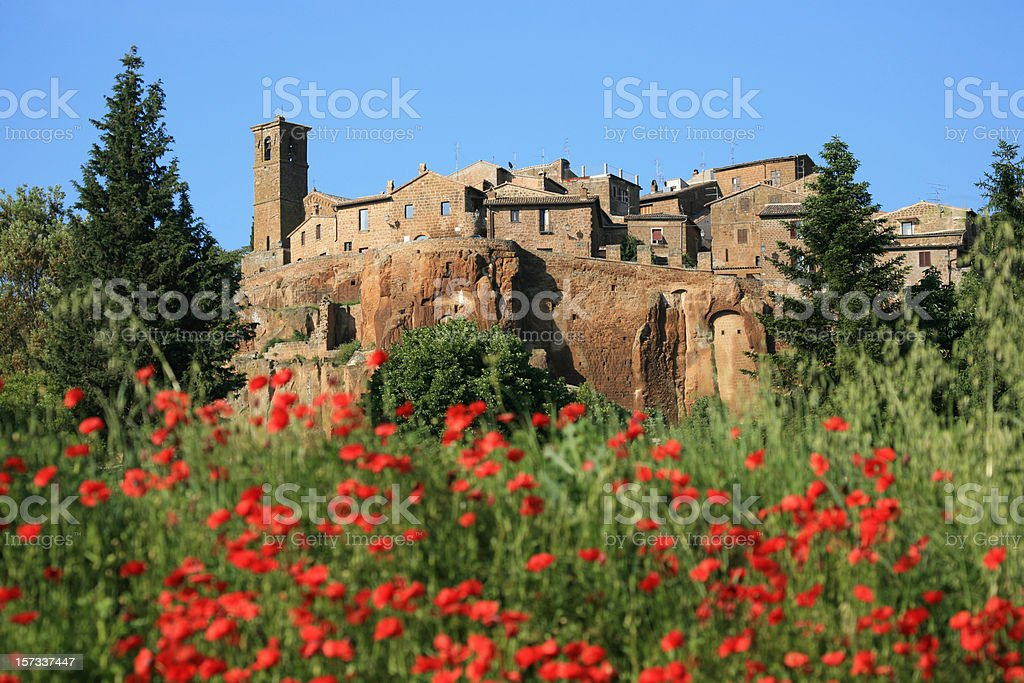 Old houses and poppies in Orvieto, Umbria Italy stock photo