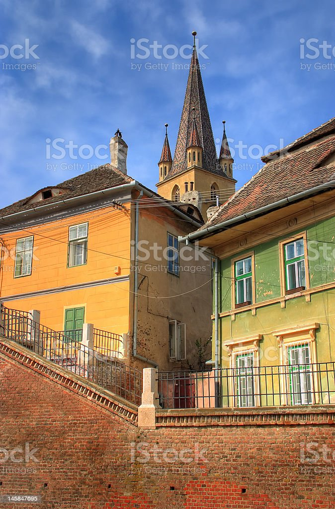Old houses in front of a church royalty-free stock photo