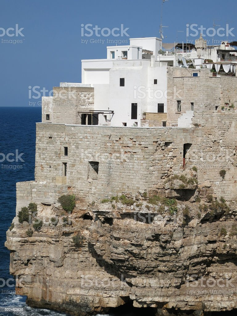 Old houses on the cliff, Polignano a Mare, Italy stock photo