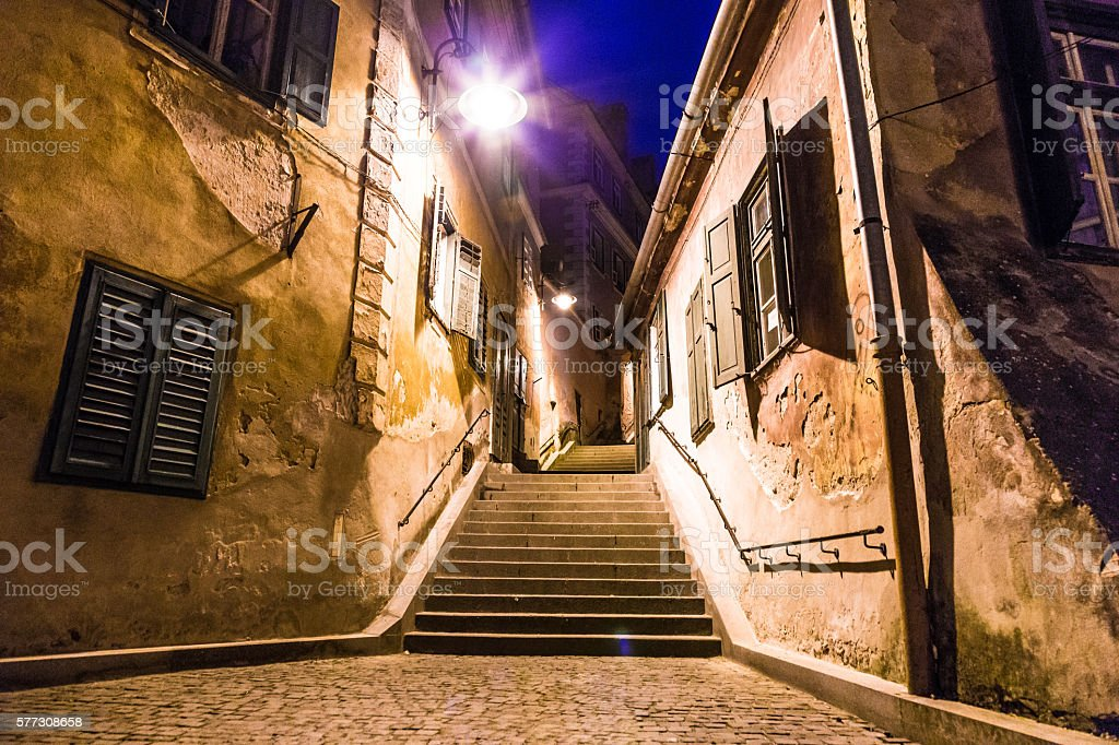 Old houses,staircase and cobbled alley in Sibiu, Romania stock photo