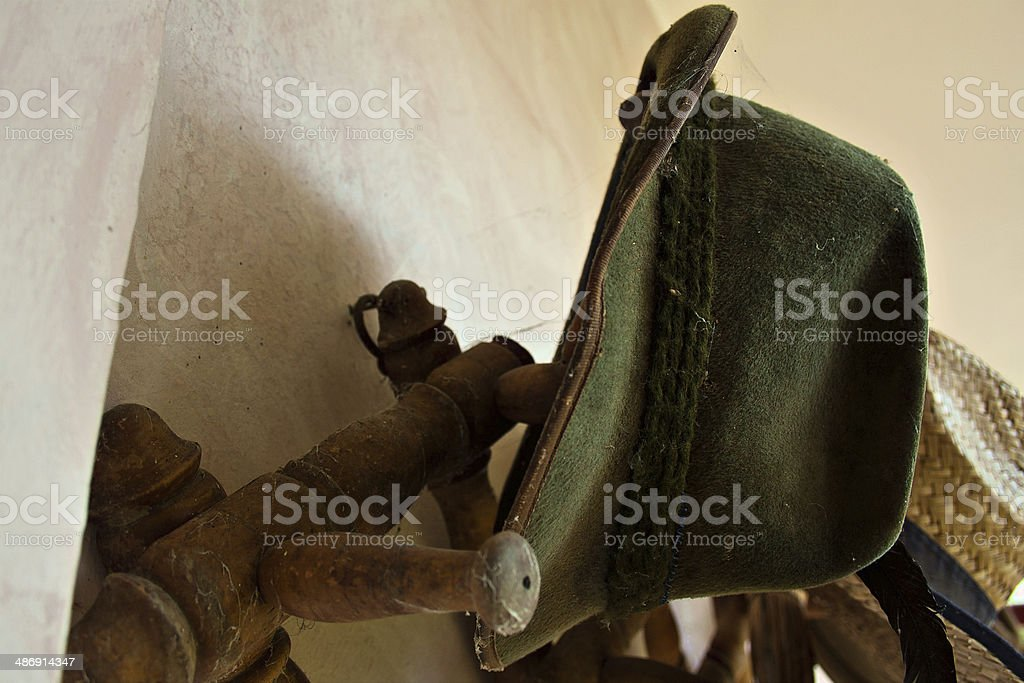 Old hunting hat now covered with dust and spider webs. stock photo