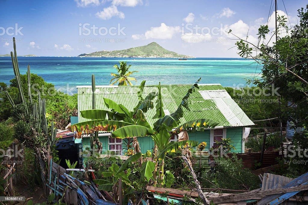 old hut near caribbean lagoon stock photo
