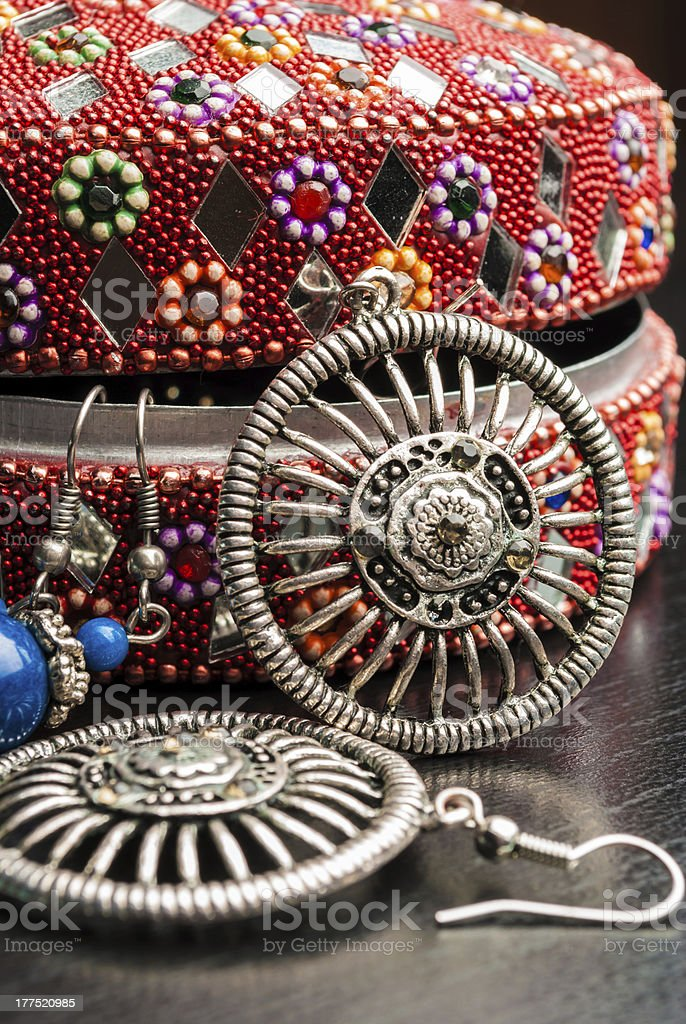 Old indian jewelery box with the earrings. royalty-free stock photo
