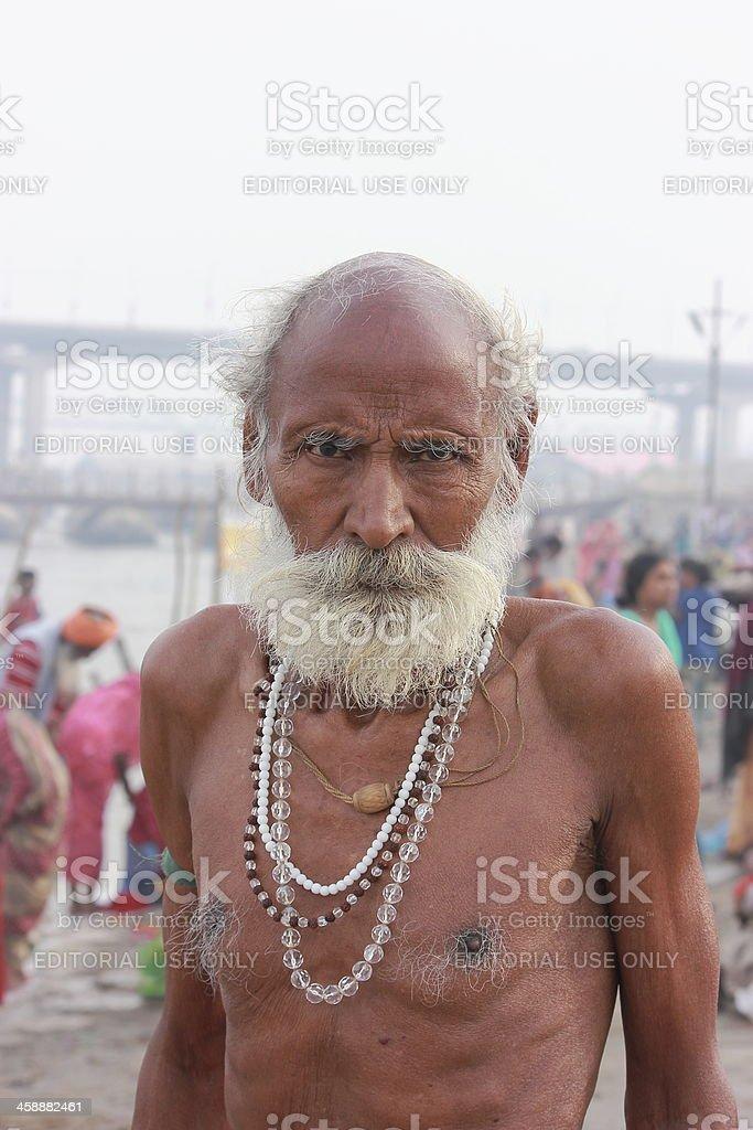 Old Indian man in Kumbh 2013 stock photo