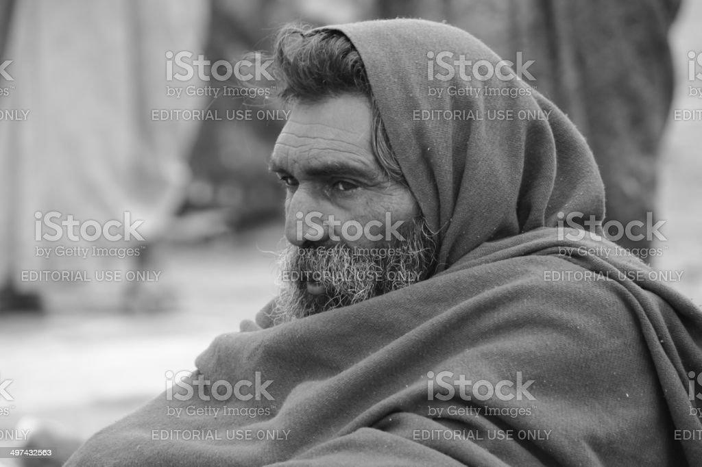 Old Indian man in Kumbh Mela - 2013 stock photo
