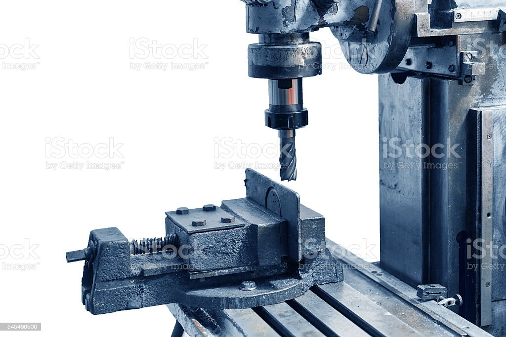 Old industrial milling machine on a white background stock photo