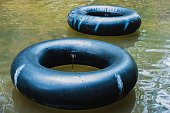 Old inner tubes floating on a river