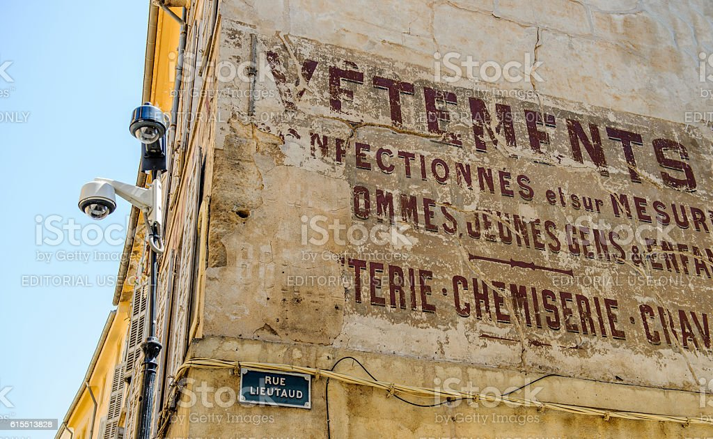 Old inscription graffiti style in center of Aix-En-Provence, France stock photo