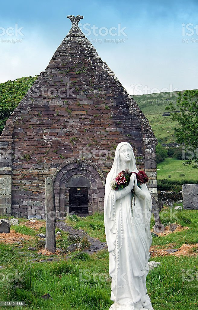 Old Irish graveyard with madonna stock photo