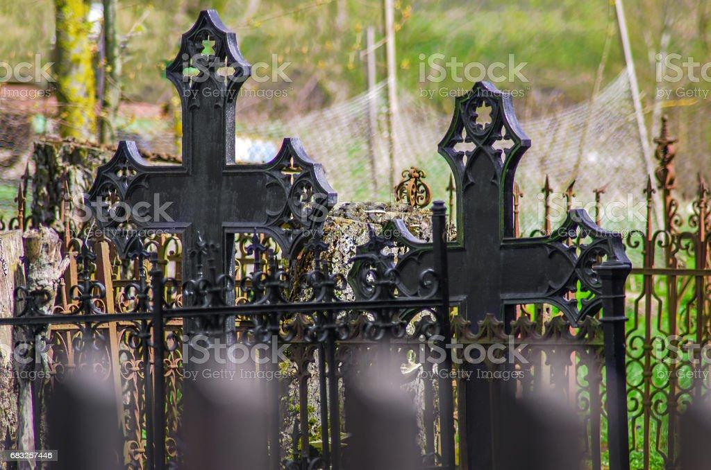 Old iron cross in cemetery stock photo