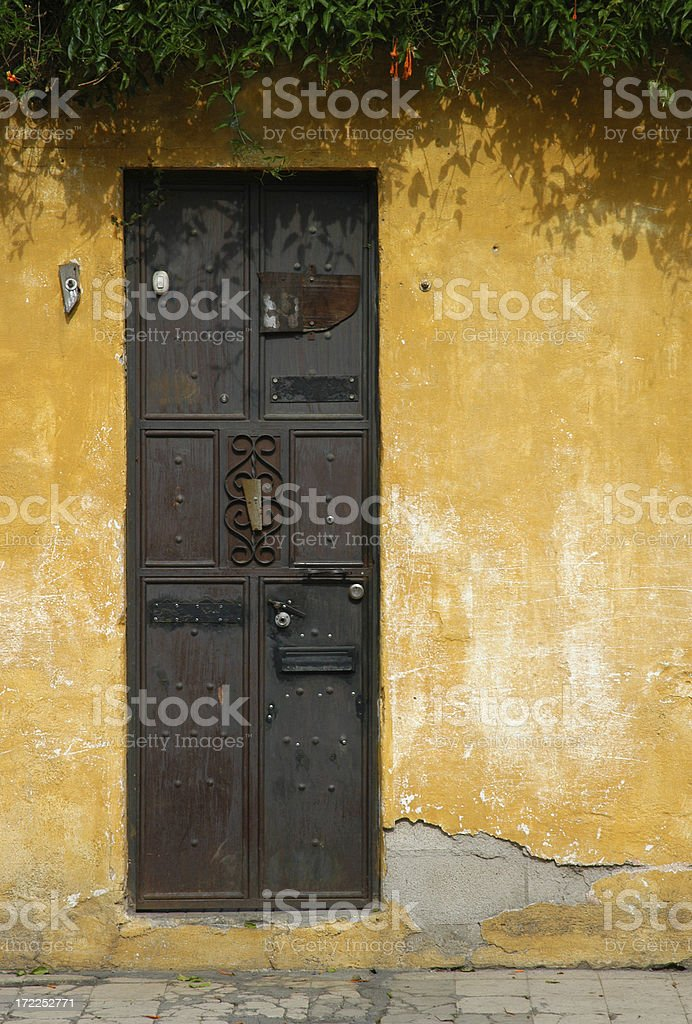 Old Iron Door and Yellow Wall royalty-free stock photo