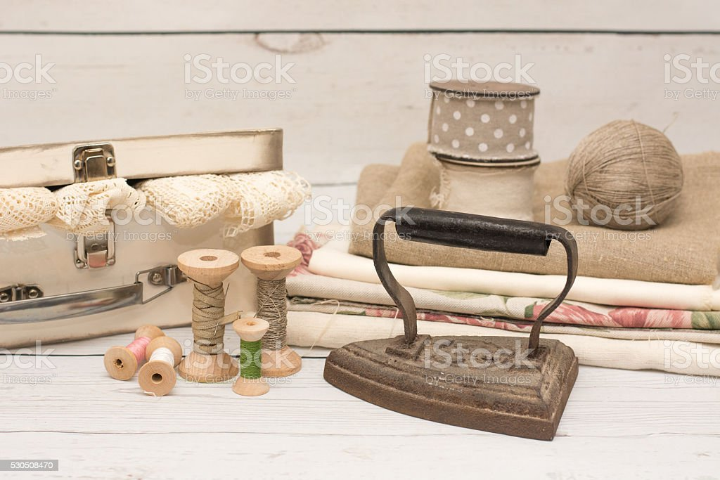 Old iron, fabric and wooden spool stock photo