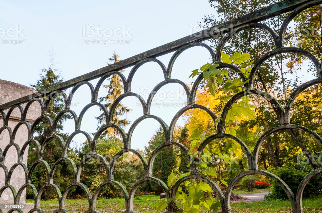 Old iron fence by city park in Penza town ( Russia ) stock photo