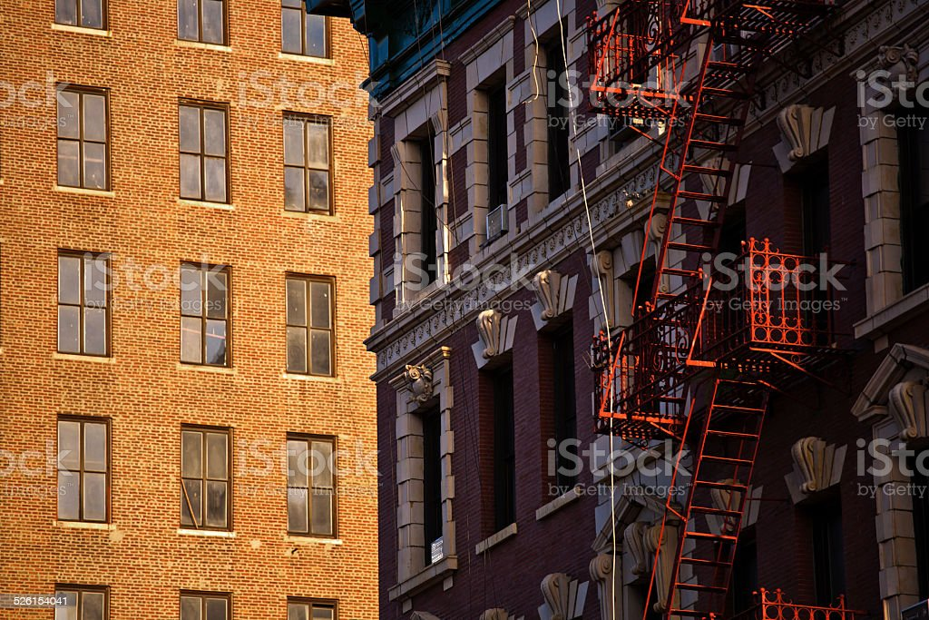 old iron fire escape rescue ladders at old houses stock photo