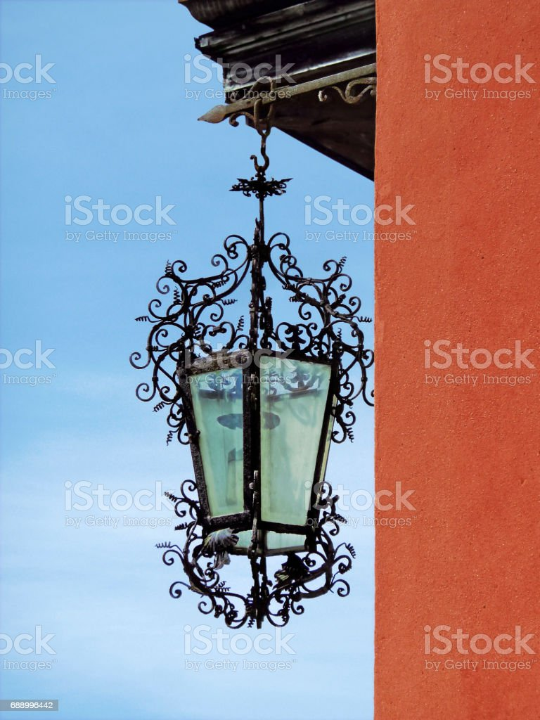 Old iron woven lantern in the city of Orta San Giulio, northern Italy stock photo