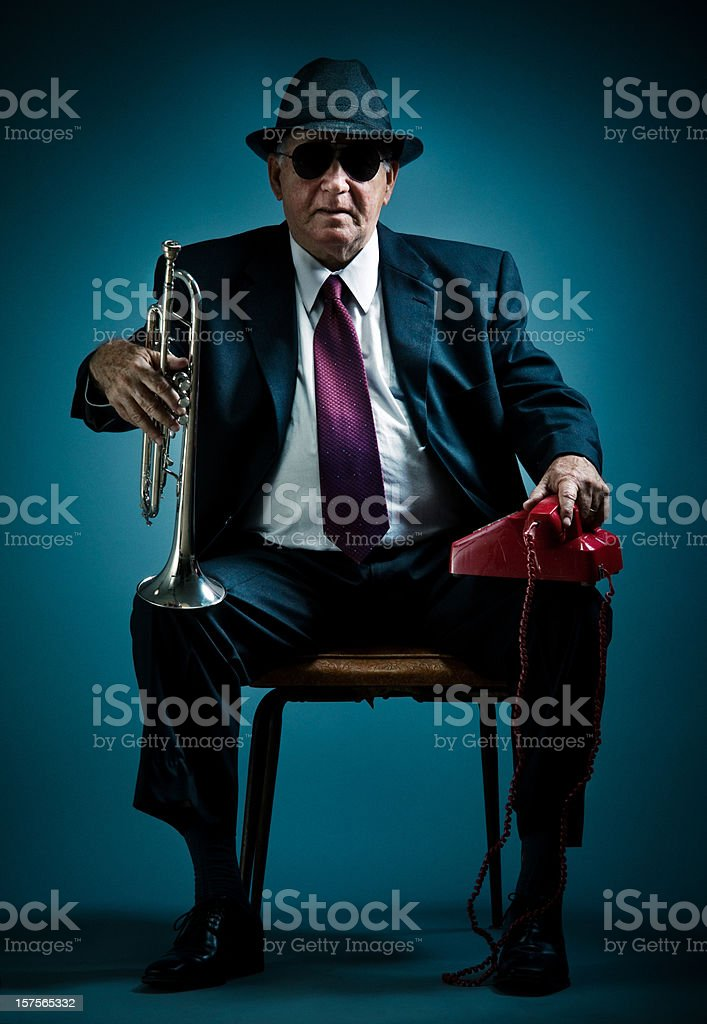 old jazz musician waiting for a phone call stock photo