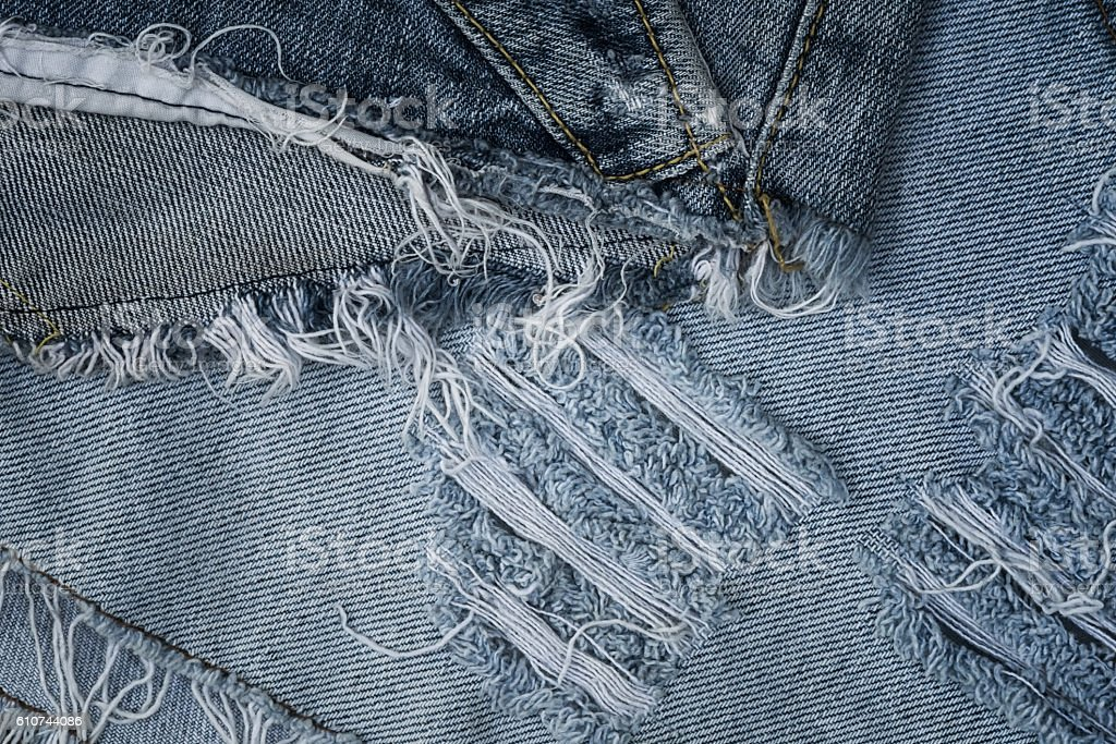 Old jean texture with a hole stock photo