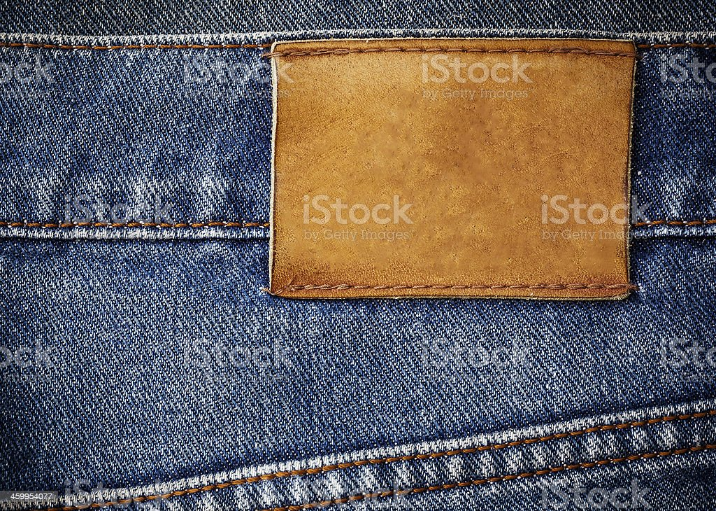 old jeans texture with leather label background close up stock photo