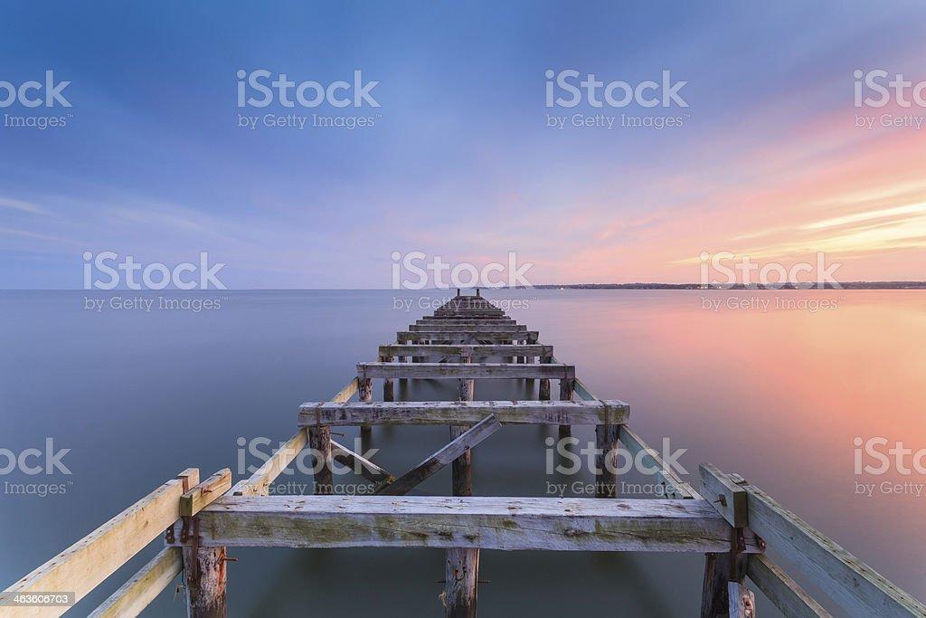 Old jetty at dusk stock photo
