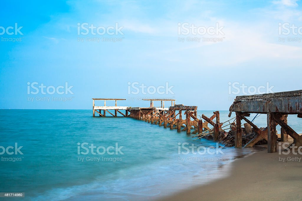 old Jetty damage at sand beach stock photo