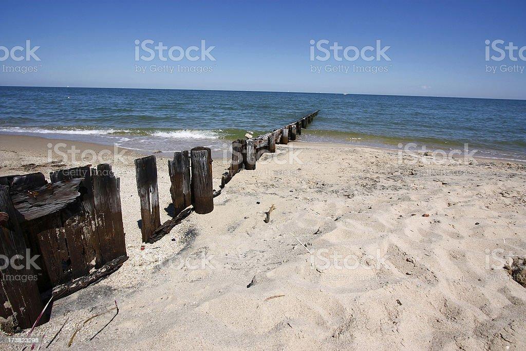 Old Jetty on coastal beach royalty-free stock photo