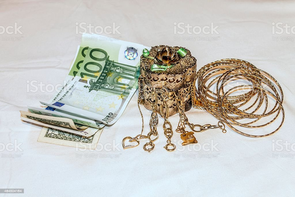 old jewelry on a white background and money stock photo