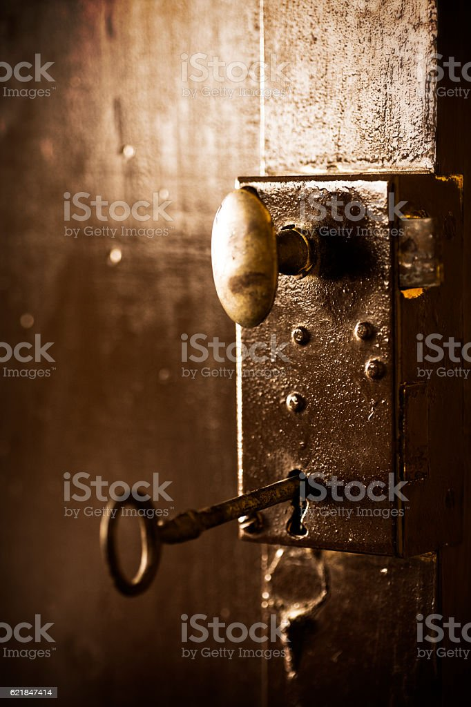 Old key in a vintage lock stock photo