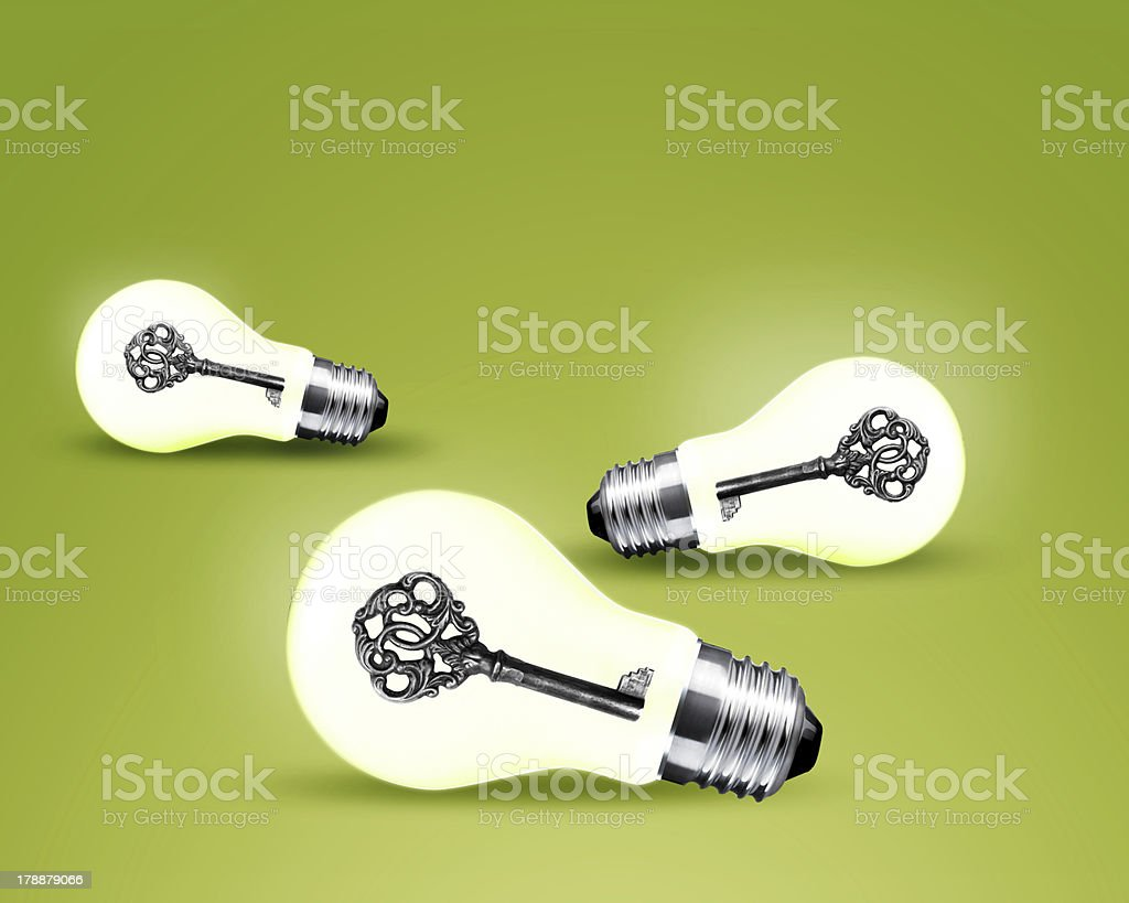 Old key in light bulb royalty-free stock photo