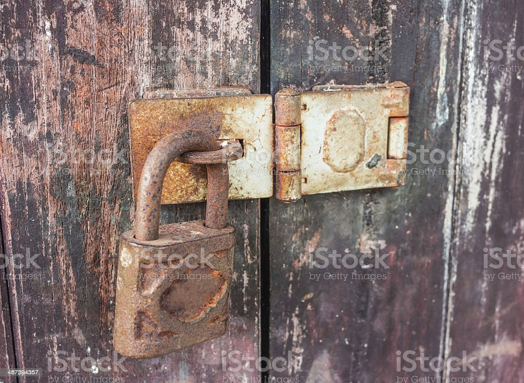 Old key lock on wooden wall stock photo