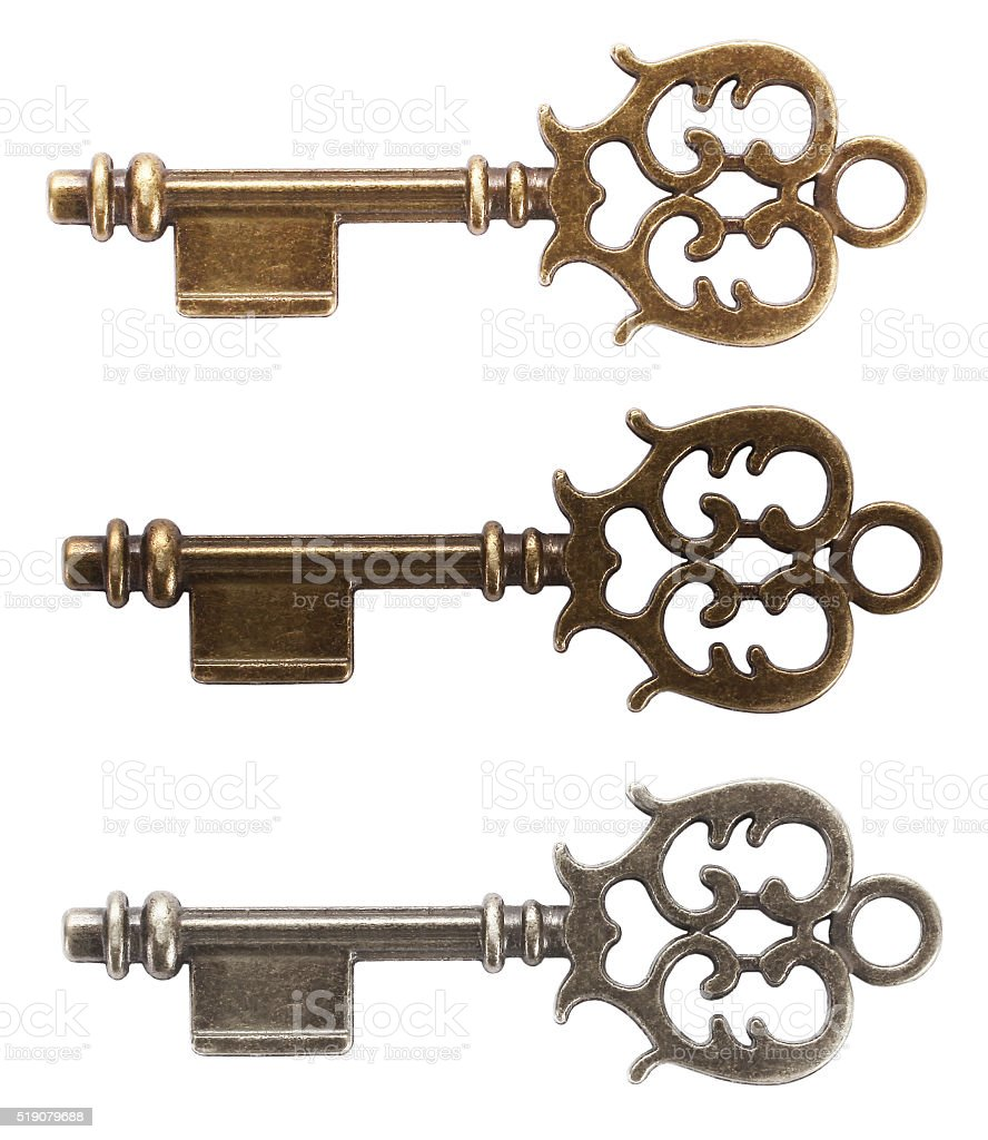 Old key made from gold, bronze or silver stock photo