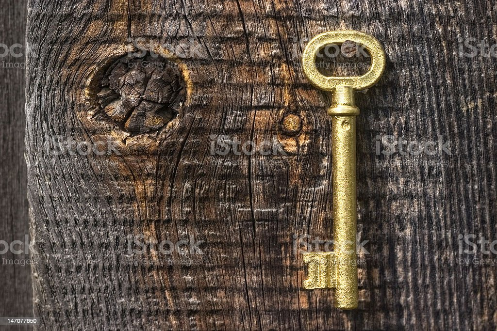 Old key of gold colour. royalty-free stock photo