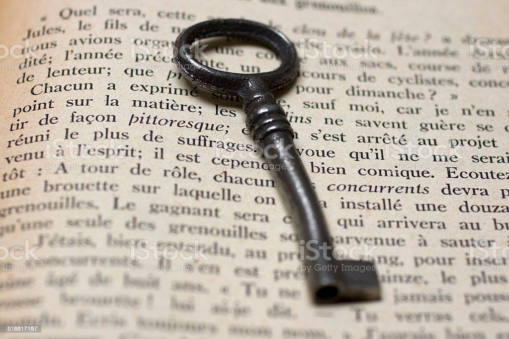Old Key on a open book stock photo