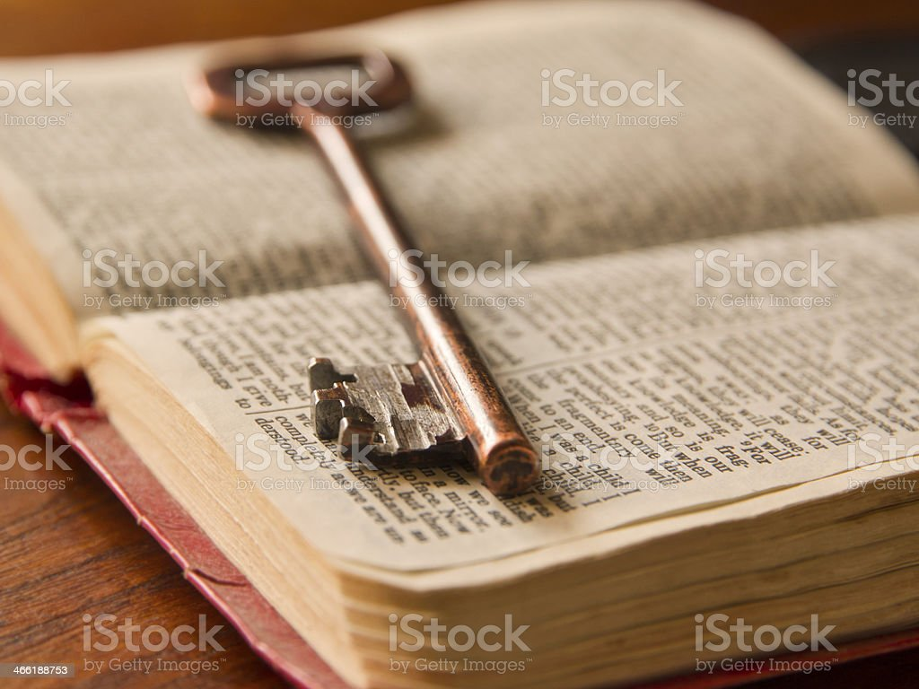 Old key on top of a Bible stock photo