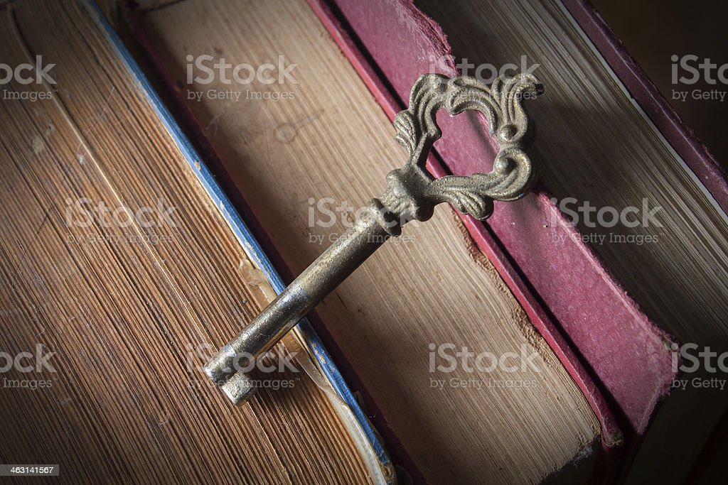 Old key with antique books royalty-free stock photo