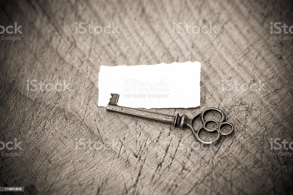 Old key with empty white page royalty-free stock photo
