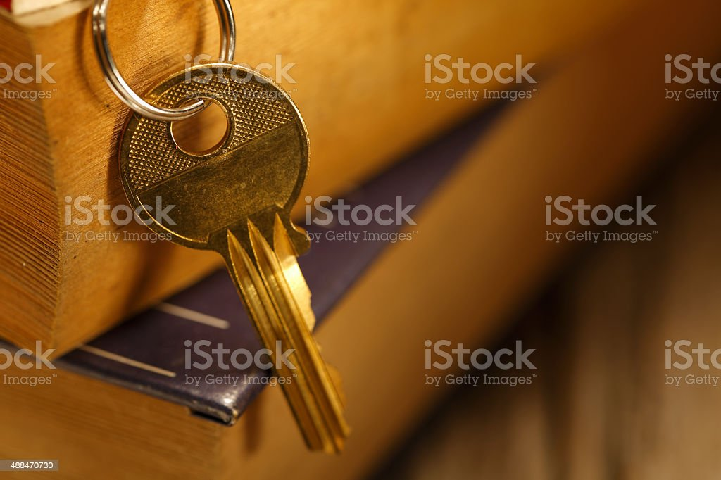 old keys on a old book stock photo