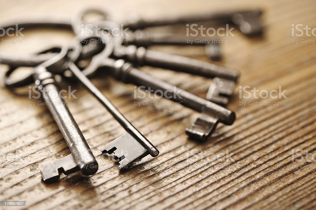 old keys on a wooden table, close-up stock photo