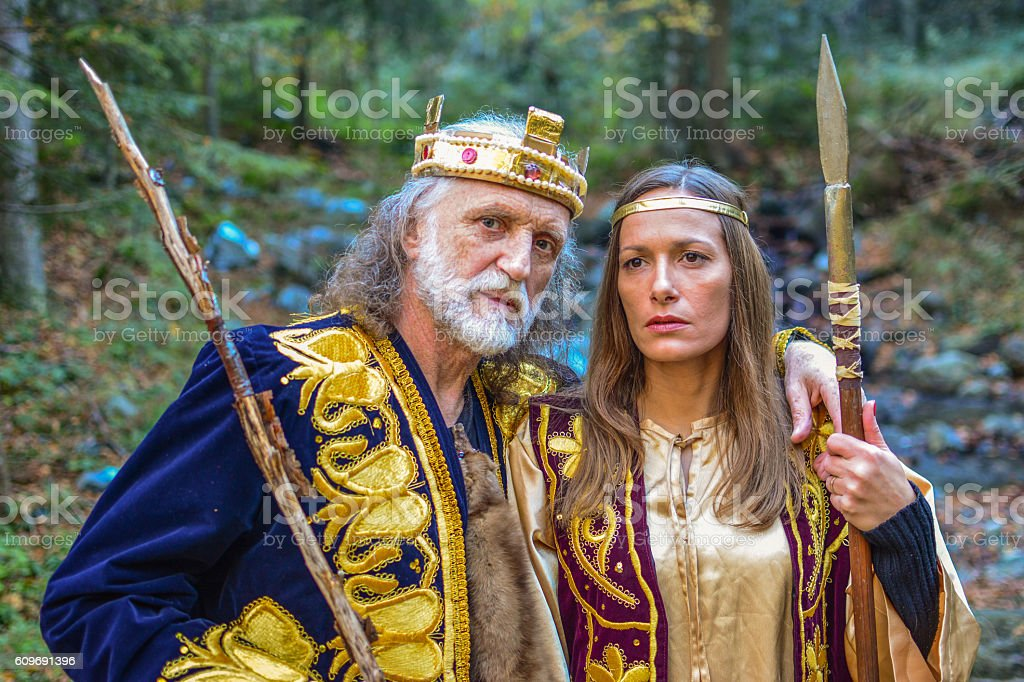Old king and queen in the forest stock photo