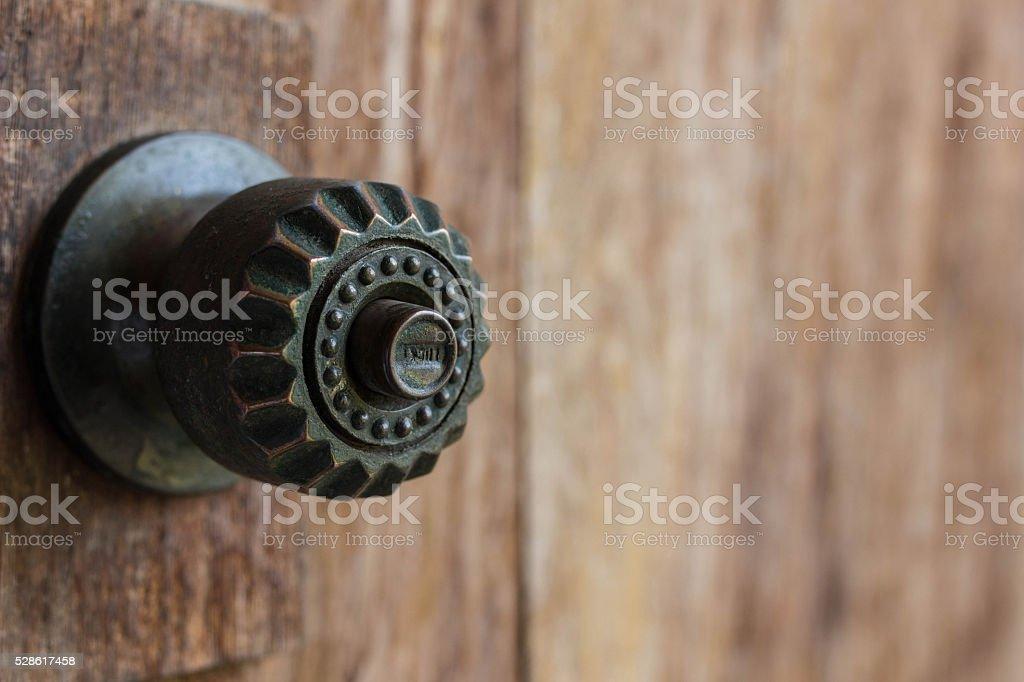 Old knob on old wooden door stock photo