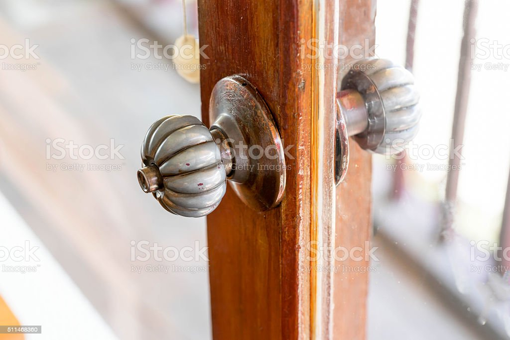 old knob on wood door and glass stock photo