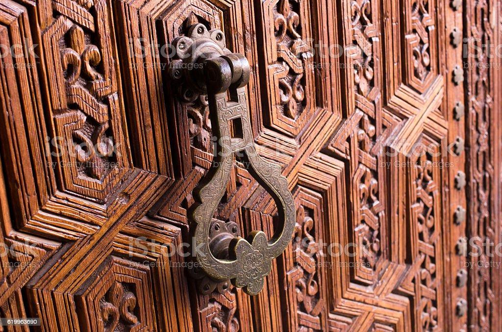 Old knocker in  wooden door stock photo