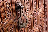 Old knocker in  wooden door