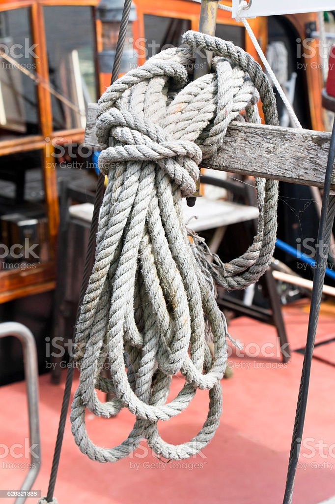 Old knotted hemp rope on a sailboat stock photo