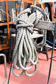 Old knotted hemp rope on a sailboat