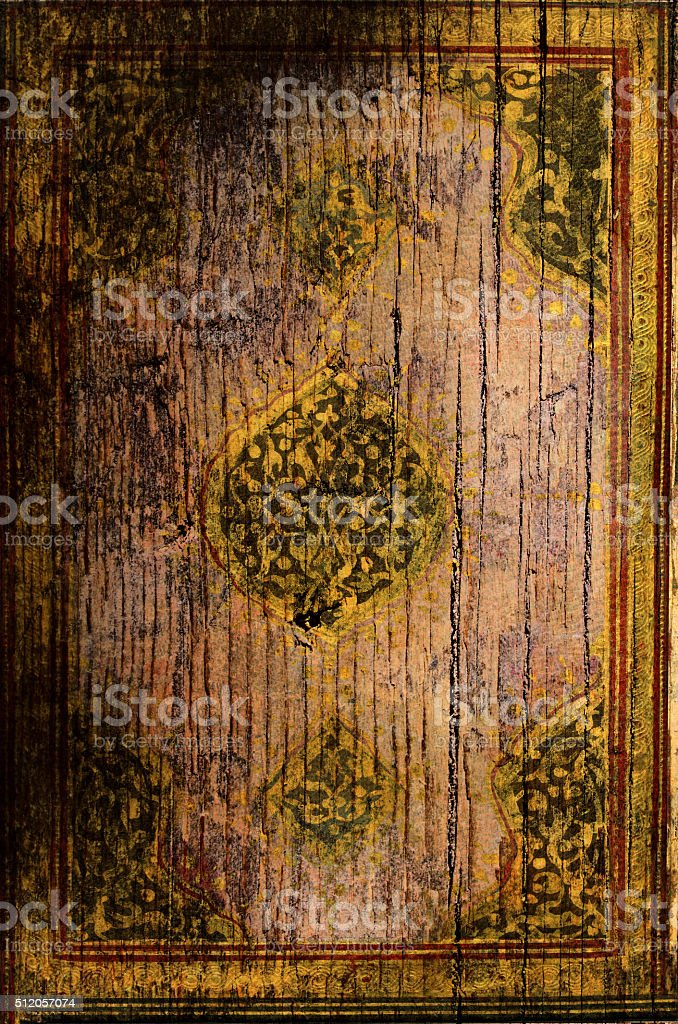Old Koran Cover worked on wood stock photo