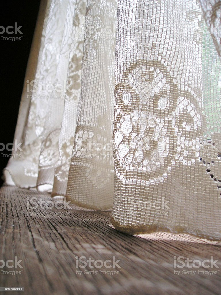 old lace cutains in a window stock photo
